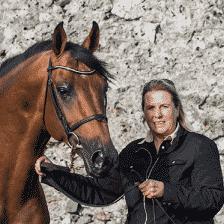 Andrea Etter Holding Stallion Celtic Hero BZ